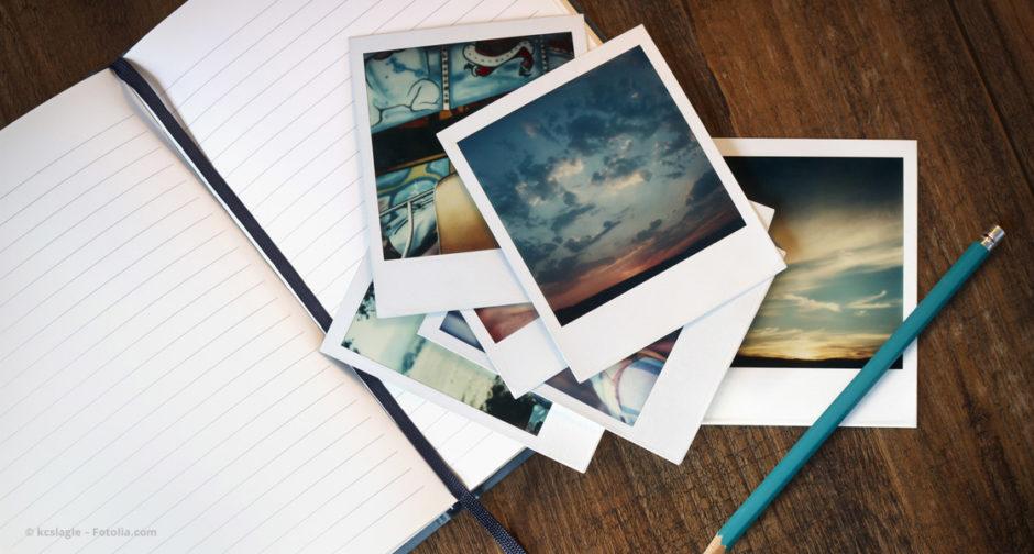 Stapel Fotos auf Notizbuch