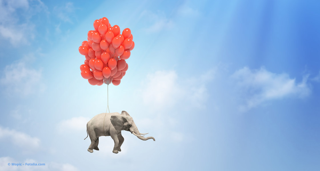 Viele rote Luftballons tragen Elefanten © Mopic – Fotolia.com